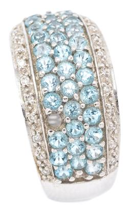 Sale 9132 - Lot 528 - A 9CT WHITE GOLD GEMSET RING; half hoop set with 3 rows of round cut blue topaz (1 missing) between borders set with round brilliant...