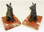 Sale 8272A - Lot 93 - A pair of French Art Deco bronzed metal dogs on rouge marble book ends 13 cm tall