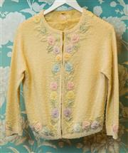 Sale 8420A - Lot 75 - A vintage cream beaded cashmere cardigan, size: 12, featuring beautiful floral cream, pink , blue & pearl beading, exquisite design,...