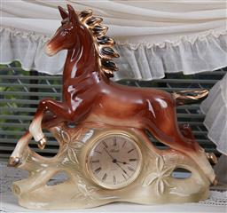 Sale 9103M - Lot 437 - A Hermle quartz horse figural clock, Height 37cm