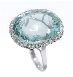 Sale 9213 - Lot 370 - AN 18CT WHITE GOLD AQUAMARINE AND DIAMOND COCKTAIL RING; featuring an oval cut aquamarine of approx. 21.5ct to a surround of 34 roun...