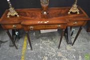 Sale 8255 - Lot 1033 - Regency Style Mahogany Breakfront Hall Table, with rosewood & brass inlays, having three drawers & turned fluted legs