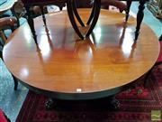 Sale 8485 - Lot 1019 - Antique Mahogany Extension Dining Table, in the William IV style, with six half-leaves & storage frame, raised on split double colum...