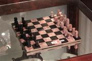 Sale 8024 - Lot 78 - Carved Rouge and Black Marble Chess Set