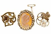 Sale 8414 - Lot 315 - THREE GOLD BROOCHES; one in 18ct with foliage, 4.4g, one with cultured pearls by Mikimoto, 6.9g, and a 9ct shell cameo, 7.7g.