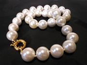 Sale 8312A - Lot 34 - A freshwater pearl shell necklace, approx. 15 mm round beads, overall length 45cm