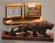 Sale 7950 - Lot 73 - Europa Clock and Calendar, and a Carved Horn Lion