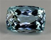 Sale 8373 - Lot 382 - AN UNSET 7.64CT AQUAMARINE; rectangular cushion cut of medium blue colour, with lab cert.