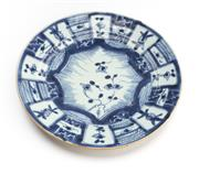 Sale 8517A - Lot 38 - An C18th Qing porcelain plate with central floral design and panels to rim, D 20cm