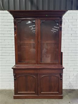 Sale 9097 - Lot 1051 - Victorian Mahogany Bookcase, the upper glazed doors with shaped astragal top, with two drawers & two arched panel doors below (h:220...