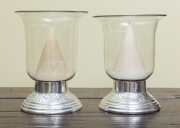 Sale 8677B - Lot 577 - A pair of storm lanterns with cone shaped candles, H x 36cm