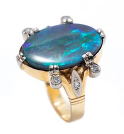 Sale 9213 - Lot 378 - AN 18CT GOLD OPAL AND DIAMOND RING; centring on a 20 x 14mm oval cut solid black opal, green/violet colours flanked by 4 round brill...