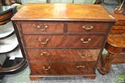 Sale 8291 - Lot 1009 - George III Mahogany Chest of Five Drawers, the cantered sides with later blind fretwork & on bracket feet (cracks)