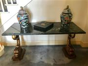 Sale 8815A - Lot 19 - A regency style carved giltwood and verde marble console table. The twin pedestals carved in form of sylised regency dolphins suppor...