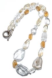 Sale 9054 - Lot 327 - A CITRINE AND ROCK CRYSTAL NECKLACE; graduated 8-28mm faceted and tumbled quartz beads between frosted bead spacers to toggle clasp,...