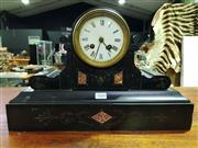 Sale 8653 - Lot 1010 - Late 19th Century French Black Slate & Marble Mantle Clock, with white enamel dial in drum shaped top, has winder & pendulum (key in...
