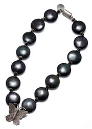 Sale 9054 - Lot 331 - A PAMELA DEAN SILVER AND STONE NECKLACE; 25.5mm wide iridescent black stone disc beads to faceted dark green beads and silver disks...