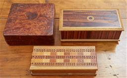 Sale 9103M - Lot 572 - A group of three timber lift top boxes including a walnut example, parquetry example with native timbers of NZ, and another, largest...