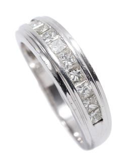 Sale 9213 - Lot 374 - AN 18CT WHITE GOLD DIAMOND RING; 5.8mm wide tapering band channel set with 10 princess cut diamonds totalling approx. 0.90ct, size O...
