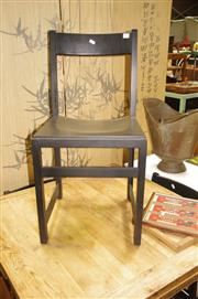 Sale 8134 - Lot 1039 - Set of Four Black Timber Square-Line Dining Chairs