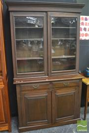 Sale 8323 - Lot 1014 - Late Victorian Stained Pine Bookcase with two glass panel doors, 2 drawers above two panel doors