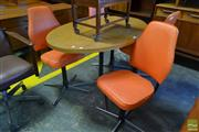 Sale 8528 - Lot 1071 - Vintage Oval Dining Table with Four Orange Swivel Chairs