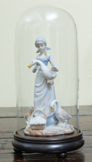 Sale 8677B - Lot 580 - A ceramic figure of mother goose under cloche, total height 33cm