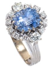 Sale 8937 - Lot 405 - AN 18CT WHITE GOLD SAPPHIRE AND DIAMOND CLUSTER RING; centring an emerald cut fine blue Ceylon sapphire of approx. 5.50ct with 5 rou...