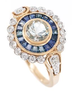 Sale 9164J - Lot 464 - AN AQUAMARINE, SAPPHIRE AND DIAMOND TARGET RING; centre collet set with a round cut light blue aquamarine of approx. 0.72ct to surro...