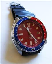 Sale 8312A - Lot 39 - A vintage Seiko, red dial 7002 7000 Stainless steel Men's dive watch.  Movement: High Grade Seiko  17 jewel automatic wind movem...