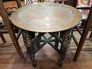 Sale 8697 - Lot 1665 - Ornate Brass Top Folding Occasional Table