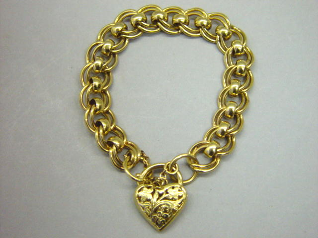 Sale 3545 - Lot 44 - A 9CT GOLD FANCY LINK BRACELET;