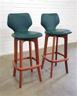 Sale 9157 - Lot 1018 - A pair of blackwood raised and green leather upholstered bar stools. Height of back 101cm, purchased at Buckleys Oct 1999