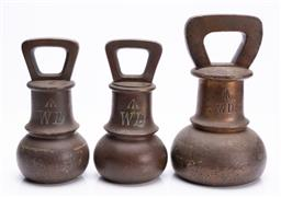 Sale 9185E - Lot 153 - A set of three graduating weights, tallest Height 23.5cm