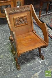 Sale 8255 - Lot 1023 - Glastonbury Style Oak Armchair, carved with a panel of the pious pelican and motto & on carved paw feet