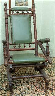 Sale 8881H - Lot 96 - A Dexter Rocker with green leather-look upholstery, Height of back 106cm