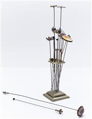 Sale 9080W - Lot 65 - A group of hatpins in a stand, including Scottish, golf and swan themes.