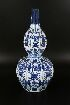 Sale 7413 - Lot 71 - A GOURD SHAPED BLUE AND WHITE VASE