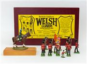 Sale 8774A - Lot 289 - A limited edition collectors models of the welsh guards by W Britain manufactured in London in box, together with a cavalry man on pl..
