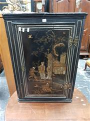 Sale 8848 - Lot 1045 - 18th Century Ebonised Small Chinoiserie Hanging Corner Cabinet, the door with a lady and attendants in  garden setting