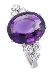 Sale 8928 - Lot 397 - AN 18CT WHITE GOLD AMETHYST AND DIAMOND RING; centring on a fine oval cut amethyst of approx. 5.50ct adjacent to six round brilliant...