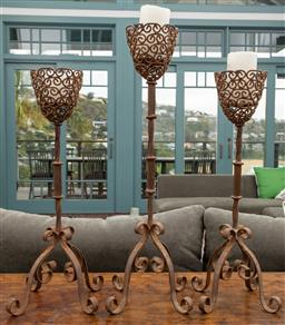 Sale 9191H - Lot 6 - Set of three rustic iron candle holders, tallest 66 cm