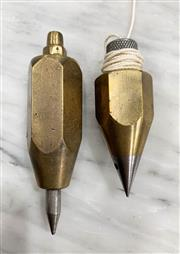 Sale 8951P - Lot 354 - Pair of Hexagolal Brass Plumb Bobs with Steel Tipf (largest - 11cm)