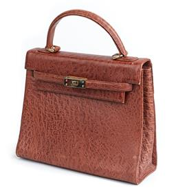Sale 9091F - Lot 232 - A TO ANYONE BROWN HANDBAG; with gold hardware, base L29cm