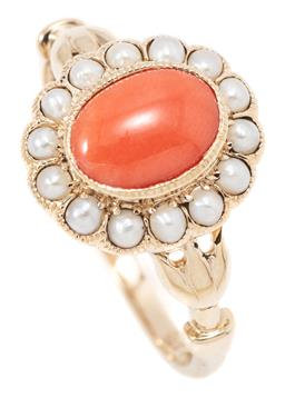 Sale 9164J - Lot 363 - A VICTORIAN STYLE CORAL AND PEARL CLUSTER RING; featuring an oval cabochon coral to seed pearl surround and stylised lotus shoulders...