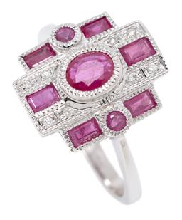 Sale 9164J - Lot 462 - A DECO STYLE RUBY AND DIAMOND RING; 9ct white gold geometric top set in the middle with an oval cut ruby flanked by 2 round cut rubi...