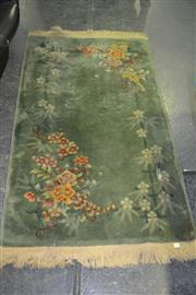 Sale 8013 - Lot 1041 - Green Rug with Floral Decoration
