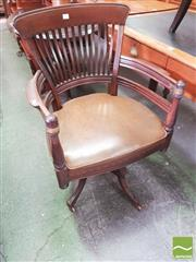 Sale 8428 - Lot 1095 - Late 19th Century American Walnut Desk Chair, with slatted back, brown vinyl seat & outswept legs (some repairs)