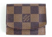 Sale 8946 - Lot 374 - A LOUIS VUITTON DAMIER EBENE CUFFLINKS CASE; with brown suede interior and date code RI0078 for France 2008, size 8 x 6cm.