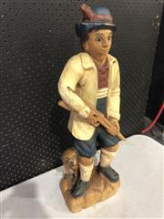 Sale 9026 - Lot 1007 - Timber Sculpture Depicting a Hunter and Dog (58cm)